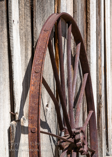 Image of Wagon wheel rim and shed